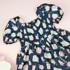 vestido-infantil-azul-petit-cherie-natural-de-tricoline-elementos-estampa