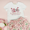 conjunto-infantil-branco-e-rosa-petit-cherie-natural-blusa-saia-romantic-bike-detalhe