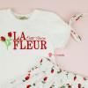 conjunto-infantil-branco-petit-cherie-natural-blusa-saia-rosas-detalhe